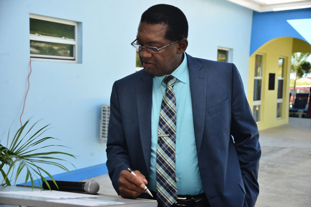 Sr. Minister of Health, Honourable Eugene Hamilton preparing for his presentation