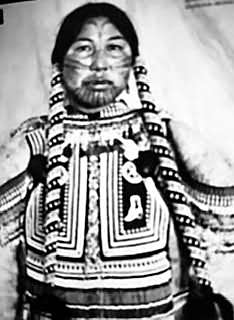 Woman in traditional Inuit costume, early 1900's. (Courtesy of the Canadian Museum of History)