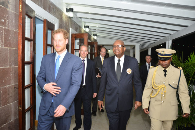 Governor General Sir Tapley Seaton escorts Prince Harry