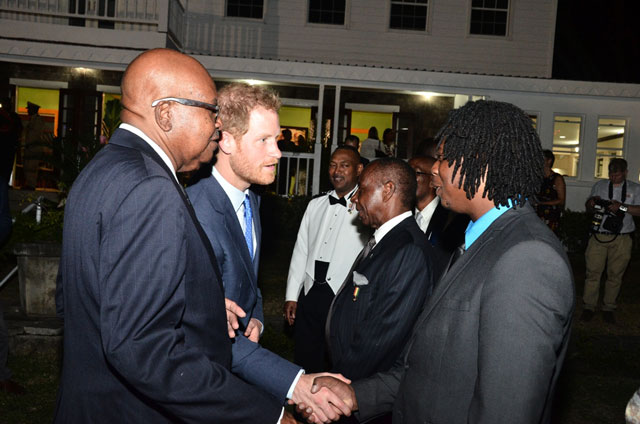 Prince Harry greets invited guests