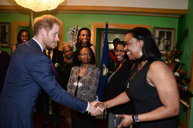 Prince Harry engages in short discussion with members of the Lawrence Family