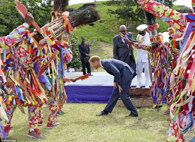 Prince Harry being entertained by Masquerades at Brimstone Hill, St. Kitts