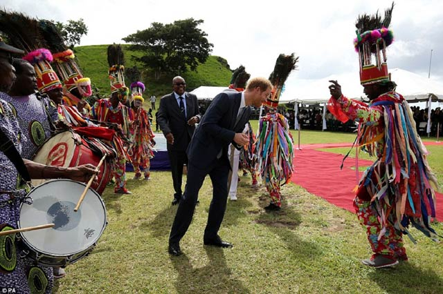 Prince Harry does the masquerade dance