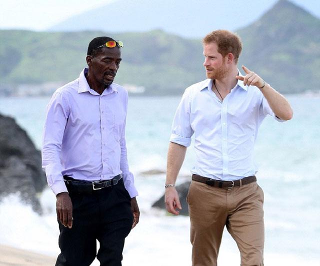 Prince Harry speaking with Lemuel Pemberton, Leader of Nevis Turtle Group