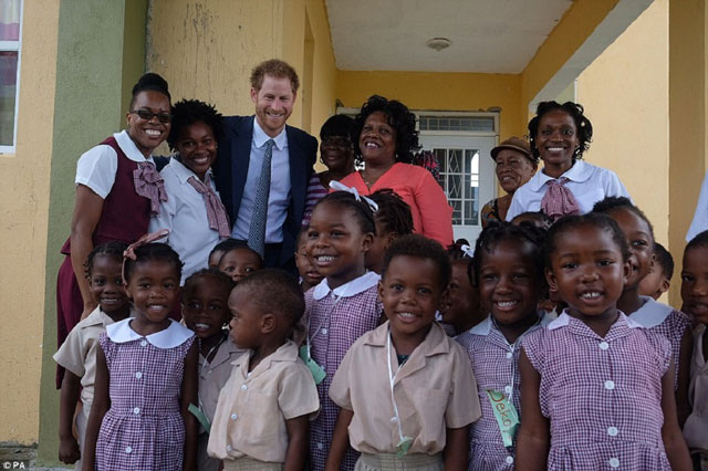 Prince Harry with school children from Half Way Tree Primary School in St. Kitts