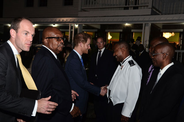 Prince Harry interacts with Commissioner of Police, Ian Queeley