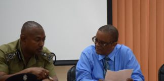 Commissioner of Police Ian Queeley and Permanent Secretary Osmond Petty of the Ministry of National Security
